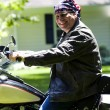Middle age man on motorcycle with american flag bandana — Foto Stock