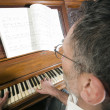 Senior middle age man playing piano — Photo