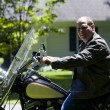 Middle age man on motorcycle with leather jacket — Foto Stock