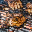Pork chops on the barbecue grill — Stock Photo