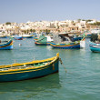 Luzzu boats harbor marsaxlokk malta — Stock Photo