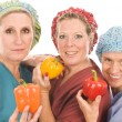 Group of nurses with healthy fruits and vegetables — Stock Photo