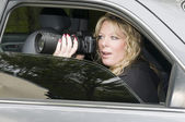 Female private investigator with camera — Stock Photo