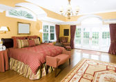 Large master bedroom with window light — Stock Photo