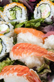 Sushi sashimi with california rolls — Stock Photo