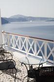 Table with chairs patio oia ia santorini caldera — Stock Photo