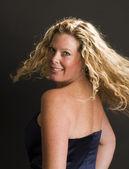Glamorous woman posing in cocktail dress — Stock Photo