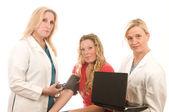 Three nurses in medical scrubs clothes — Stock Photo