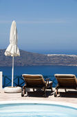 Swimming pool view of volcanic island and mediterranean sea — Stock Photo