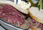 Corn beef with chopped liver sandwich on rye bread — Stock Photo