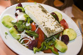 Greek salad in taverna restaurant — Stock Photo