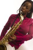 Young hispanic black woman playing tenor saxophone — Stock Photo