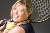Woman practicing tennis stroke — Stock Photo