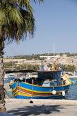 Marsaxlokk malta fishing village luzzu boat — Foto Stock