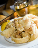 Fried calamari greek island food specialty — Stock Photo