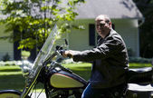 Middle age man on motorcycle with leather jacket — Stock Photo