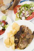 Lamb in the paper greek island taverna food — Stock Photo