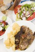 Lamb in the paper greek island taverna food — Stock Photo