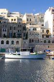 Old fishing boat st. julians harbor real estate overdevelopment — Stock Photo