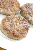 Pork sausage patties — Stock Photo