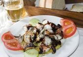 Greek island taverna specialty of marinated grilled octopus — Stock Photo