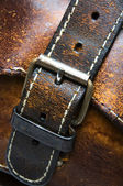 Old worn leather bag buckle detail — Stock Photo
