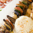 Beef shish kabob on skewer with rice Nicaragua — Stock Photo