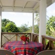 Dining table patio budget guest house bequia — Stock Photo