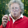 Royalty-Free Stock Photo: Senior man smoking big cigar