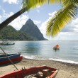 Soufriere st. lucia twin piton mountain peaks with fishing boat  — Stock Photo