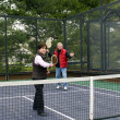 Man and woman playing paddle platform tennis — Stock Photo #23057314