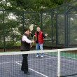 Stock Photo: Man and woman playing paddle platform tennis
