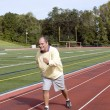 Middle age senior man exercising running on sports field and run — Stock Photo #23057598