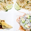 Combination plate of pai thai rice noodles food california rolls — Photo