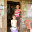 Mother daughter native house Big Corn Island Nicaragua — Stock Photo #23058348