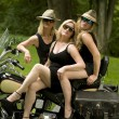 Three sexy middle age women on motorcycle — Stock Photo