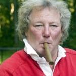 Senior man smoking big cigar — Stock Photo #23059034