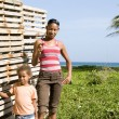 Mother daughter by lobster pot trap Corn Island Nicaragua — Stock Photo