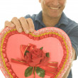 Selective focus Valentine candy box middle age man — Stock Photo