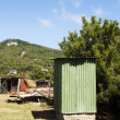 Outhouse toilet with chicken coop grenadine islands — Stock Photo #23059790