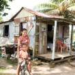 Royalty-Free Stock Photo: Nicaragua mother daughter bicycle poverty house Corn Island