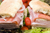 Gourmet italian combo sandwich ciabatta bread — Stock Photo
