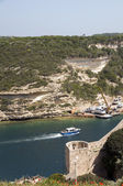 Boat entering port bonifacio corsica — Stock Photo