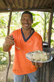 Native Nicaragua man freshly cooked seafood rondon rundown food — Stock Photo