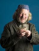 Handsome middle age man flag bandana leather jacket cash money — Stock Photo