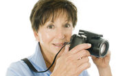 Female middle age senior lady compact digital camera — Stock Photo