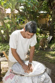 Man making coconut oil Nicaragua Corn Island Central America — Stock Photo