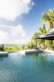 Caribbean island villa pool with lovely view of grenadine island — Stock Photo