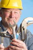 Smiling happy contractor builder with tools — Stock Photo