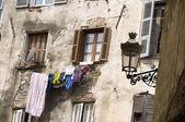 Laundry hanging medieval architecture bastia corsica — Stock Photo